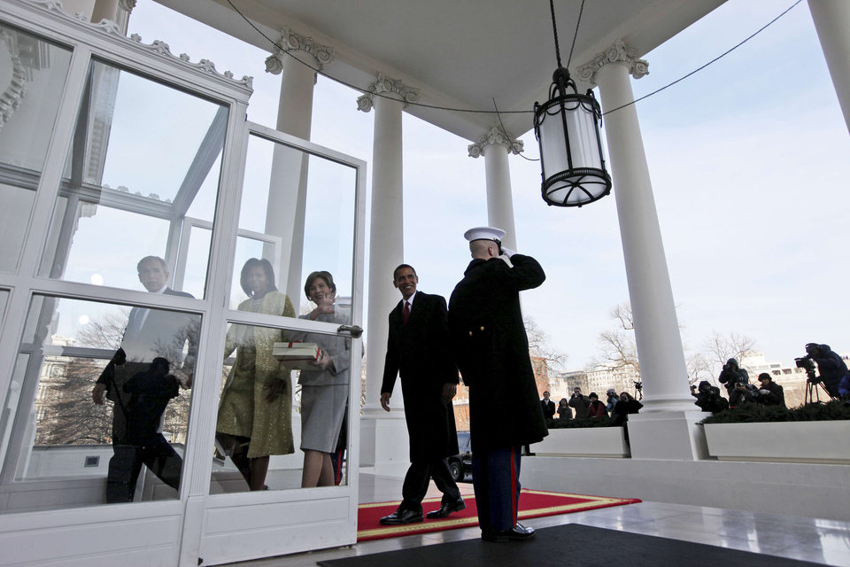 Photo - President-elect Barack Obama and Michelle Obama are welcomed to the North Portico of the White House by President George W. Bush and first lady Laura Bushin Washington, Tuesday, Jan. 20, 2009. (AP Photo/Pablo Martinez Monsivais)