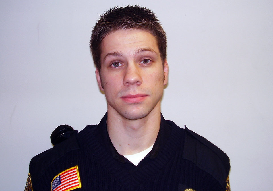 This photo provided by the Minnesota Department of Public Safety shows Cold Spring, Minn., police officer Tom Decker who was shot twice and died Thursday, Nov. 29, 2012 in what authorities are calling an ambush killing. Officials says Decker was responding to a call from a concerned family member about a man in Cold Spring, Minn., who might be suicidal. Thirty-four-year-old Ryan Michael Larson of Cold Spring was arrested at the scene and prosecutors are reviewing the case for charges. (AP Photo/Stearns County Sheriff)