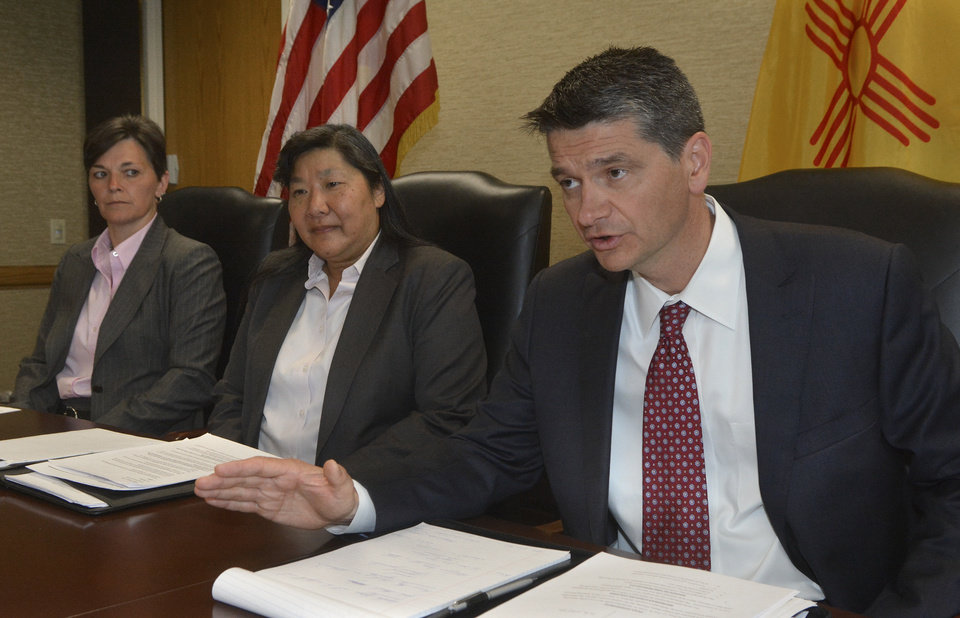 Photo - U.S. Attorney Damon Martinez, right , with FBI agents Renae McDermott, left, and Carol Lee talk about the guilty plea entered by Jamie Estrada, 41, of Los Lunas, N,M, , during a news conference in Albuquerque, Monday, June 16, 2014. Estrada pleaded guilty to the unlawful interception of electronic communications and false statements charges arising out of the unlawful interception of emails intended for others, including New Mexico Governor Susana Martinez and members of her staff in Federal Court in Albuquerque.  (AP Photo/The Albuquerque Journal, Greg Sorber)