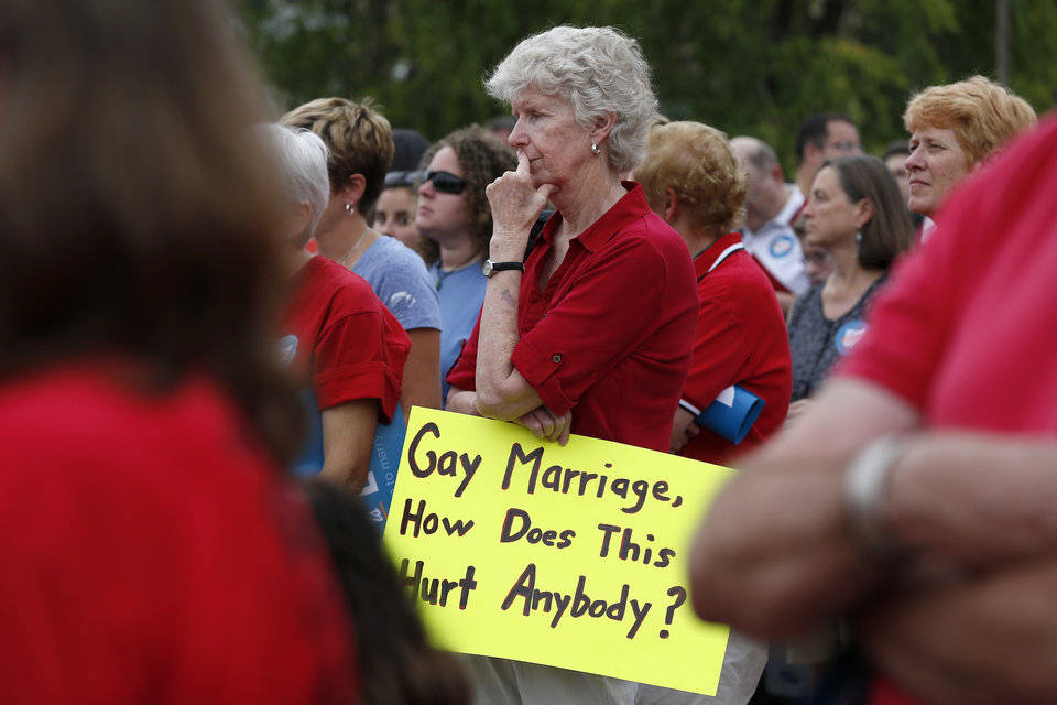 Photo - Jean Dawell of Delhi joined hundred of others along with the group Why Marriage Matters Ohio at a rally for gay marriage in Lytle Park, Tuesday, Aug. 5, 2014 in Cincinnati. Federal appeals courts soon will hear arguments in gay marriage fights from nine states, part of a slew of cases putting pressure on the U.S. Supreme Court to issue a final verdict. (AP Photo/The Cincinnati Enquirer, Jeff Swinger)