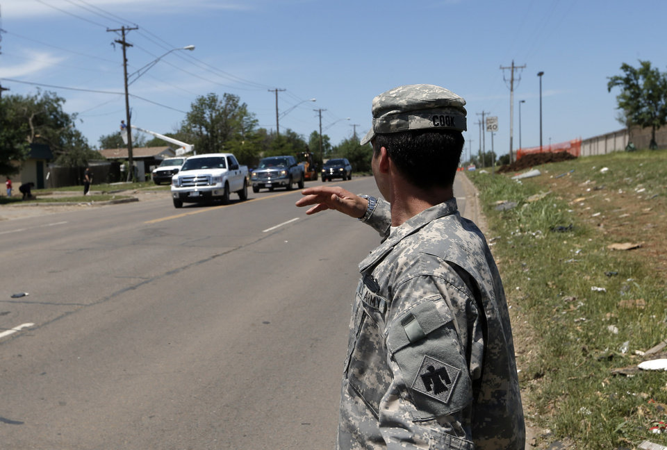 Pvt. First Class Korey Cook with the Oklahoma National Guard mans checkpoint Moore, Okla., Wednesday, May 22, 2013. Photo by Sarah Phipps, The Oklahoman