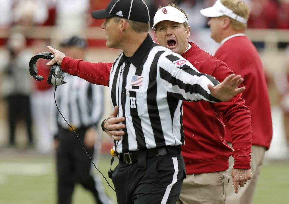 Photo - Oklahoma coach Bob Stoops argues with an official after a flag during a college football game between the University of Oklahoma (OU) and Texas Tech University at Jones AT&T Stadium in Lubbock, Texas, Saturday, Oct. 6, 2012. Oklahoma won 41-20. Photo by Bryan Terry, The Oklahoman