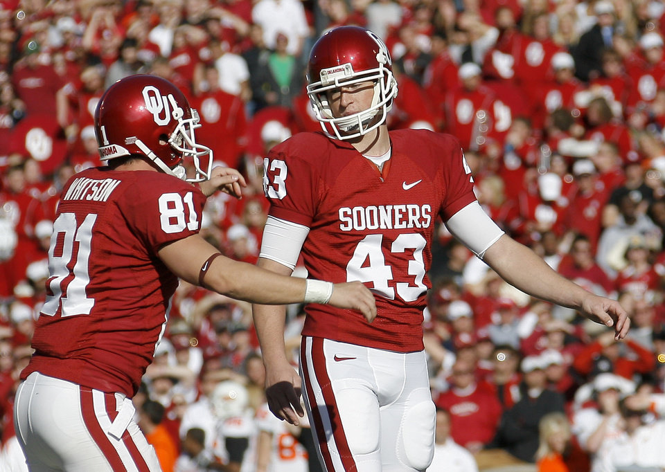 Photo - OU's Patrick O'Hara celebrates with Carter Whitson, at left, after a field goal during the second half of the Bedlam college football game between the University of Oklahoma Sooners (OU) and the Oklahoma State University Cowboys (OSU) at the Gaylord Family-Oklahoma Memorial Stadium on Saturday, Nov. 28, 2009, in Norman, Okla.Photo by Bryan Terry, The Oklahoman