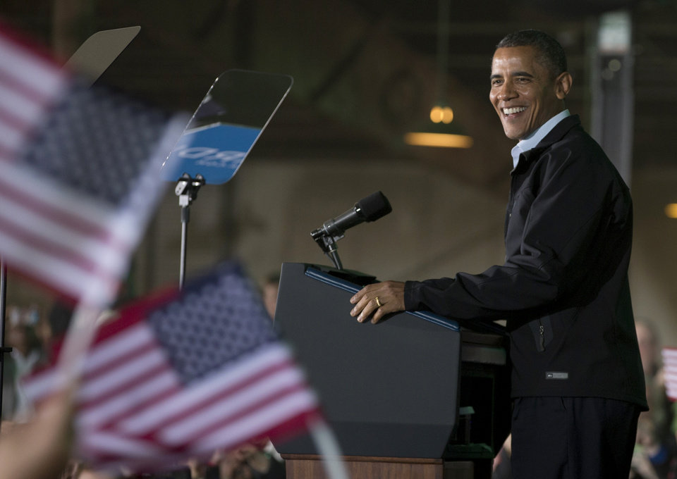 Photo -   President Barack Obama smile as he speaks at a campaign event at the Franklin County Fairgrounds, Friday, Nov. 2, 2012, in Hilliard, Ohio, before heading to another campaign stop in in Springfield, Ohio. (AP Photo/Carolyn Kaster)