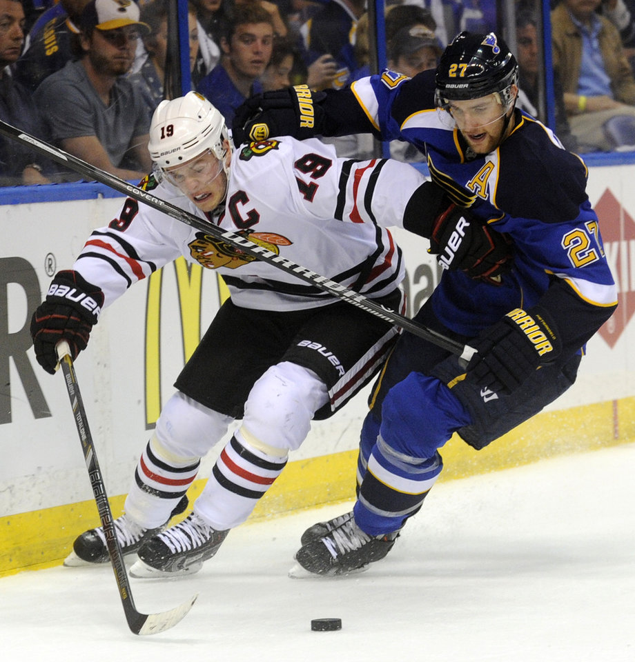 Photo - St. Louis Blues' Alex Pietrangelo (27) and Chicago Blackhawks' Jonathan Toews (19) battle for the puck during the first period in Game 2 of a first-round NHL hockey playoff series, Saturday, April 19, 2014, in St. Louis. (AP Photo/Bill Boyce)
