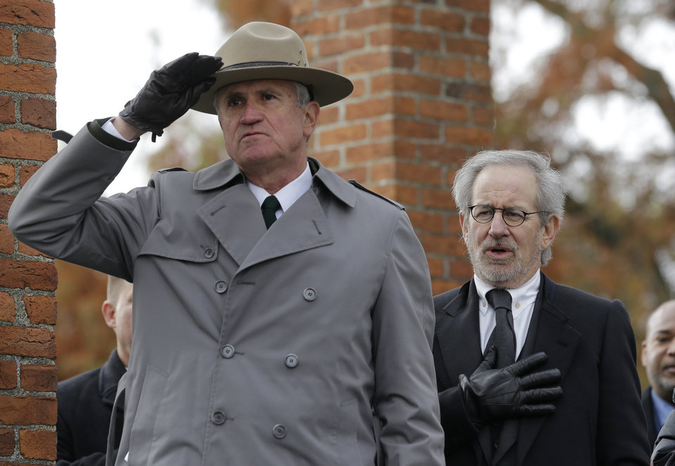 Photo -   Director Steven Spielberg, right, recites the Pledge of Allegiance alongside Bob Kirby, Superintendent of Gettysburg National Military Park, during a ceremony to mark the 149th anniversary of President Abraham Lincoln's delivery of the Gettysburg Address at Soldier's National Cemetery in Gettysburg, Pa., Monday, Nov. 19, 2012. Spielberg and historian Doris Kearns Goodwin delivered remarks and participated in a wreath-laying ceremony. (AP Photo/Patrick Semansky)