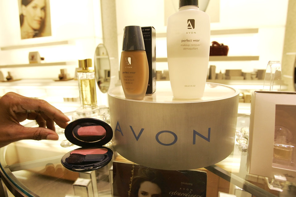 Photo -   FILE - In this file photo made Nov. 15, 2005, a saleswoman, who did not give her name, places items for a picture on display in an Avon store in New York. Avon Products Inc. says it has tapped one-time Johnson & Johnson executive Sherilyn S. McCoy as its new CEO as the struggling beauty products company looks to regain its past luster, according to reports Monday, April 9, 2012. McCoy will take over the post from Andrea Jung, who will stay on as executive chairman. (AP Photo/Gregory Bull, File)