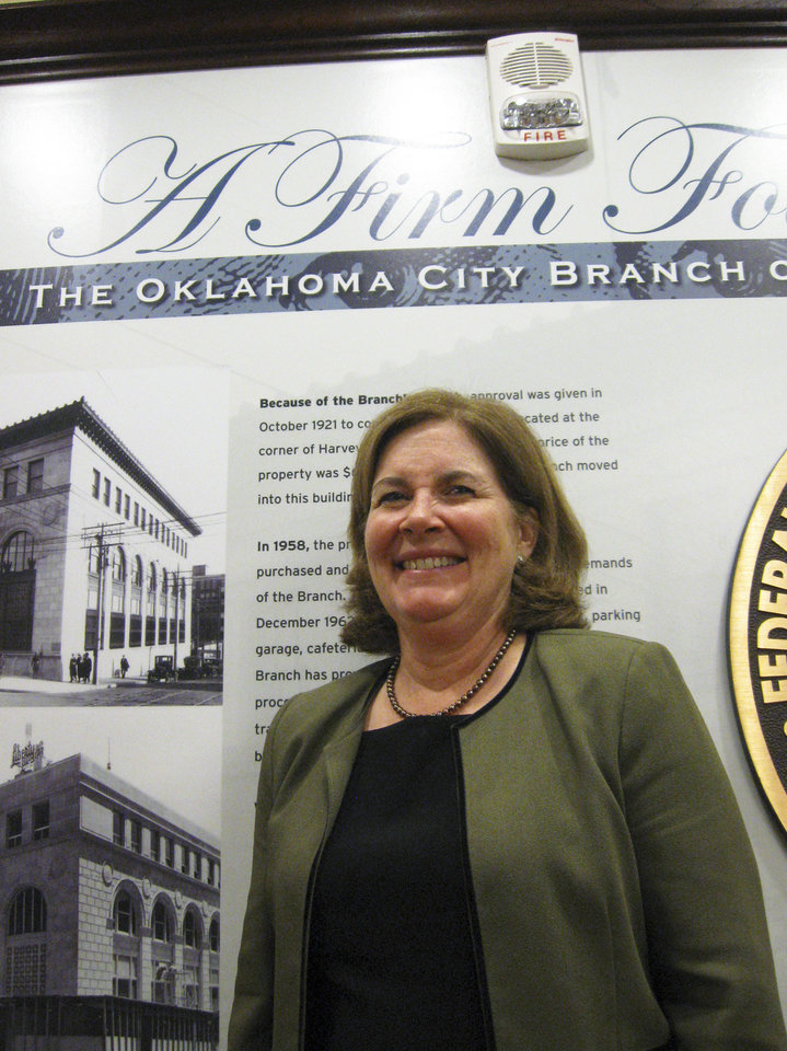 Esther George, president of the Kansas City Federal Reserve Bank, stands Tuesday in the lobby of the bank�s Oklahoma City branch. Photo by DON MECOY, THE OKLAHOMAN