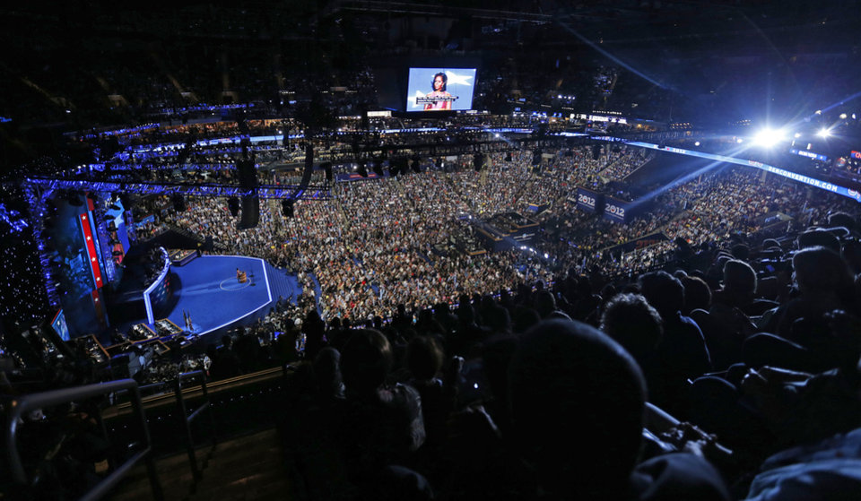 Photo - First lady Michelle Obama addresses the Democratic National Convention in Charlotte, N.C., on Tuesday, Sept. 4, 2012. (AP Photo/Carolyn Kaster)  ORG XMIT: DNC197