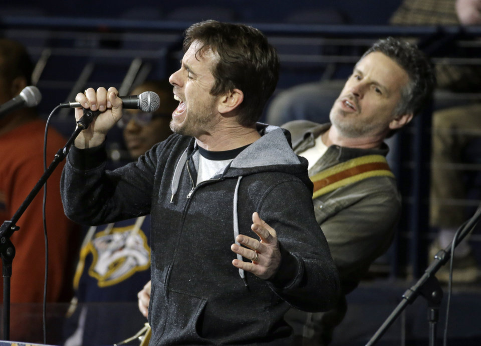 Photo - Actor Charles Esten, left, from the television show