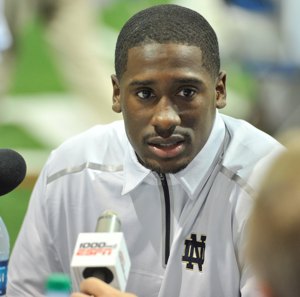 Photo - Notre Dame quarterback Everett Golson answers a question  during media day for the NCAA college football team Tuesday Aug. 19, 2014, in South Bend, Ind. (AP Photo/Joe Raymond)