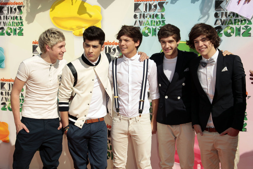 FILE - In this March 31, 2012 file photo, One Direction, from left, Niall Horan, Zayn Malik, Louis Tomlinson, Liam Payne, and Harry Styles arrive at Nickelodeon's 25th Annual Kids' Choice Awards in Los Angeles. On Nov. 13, 2012, One Direction released its sophomore album, �Take Me Home,� which comes eight months after the boy band dropped its debut, �Up All Night,� which debuted at No. 1 and is platinum. (AP Photo/Chris Pizzello File)
