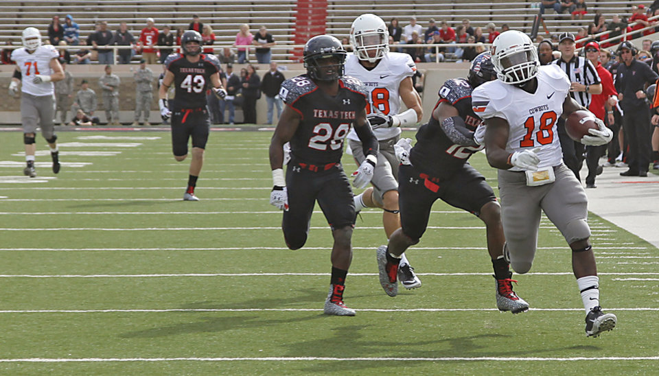 Photo - Oklahoma State's Herschel Sims (18) out runs Texas Tech Red Raiders defensive back Jared Flannel (22) and D.J. Johnson (12) during the college football game between the Oklahoma State University Cowboys (OSU) and Texas Tech University Red Raiders (TTU) at Jones AT&T Stadium on Saturday, Nov. 12, 2011. in Lubbock, Texas.  Photo by Chris Landsberger, The Oklahoman  ORG XMIT: KOD