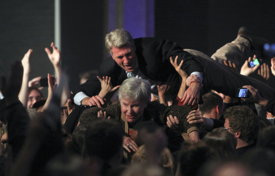 Photo -   Minneapolis Mayor R.T. Rybak goes crowd surfing with his mother Loraine, after it was announced that President Barack Obama had won re-election, Tuesday, Nov. 6, 2012, at the Minnesota DFL Party headquarters at the Crowne Plaza Hotel in downtown St. Paul, Minn. (AP Photo/The Star Tribune, David Joles) MANDATORY CREDIT; ST. PAUL PIONEER PRESS OUT; MAGS OUT; TWIN CITIES TV OUT