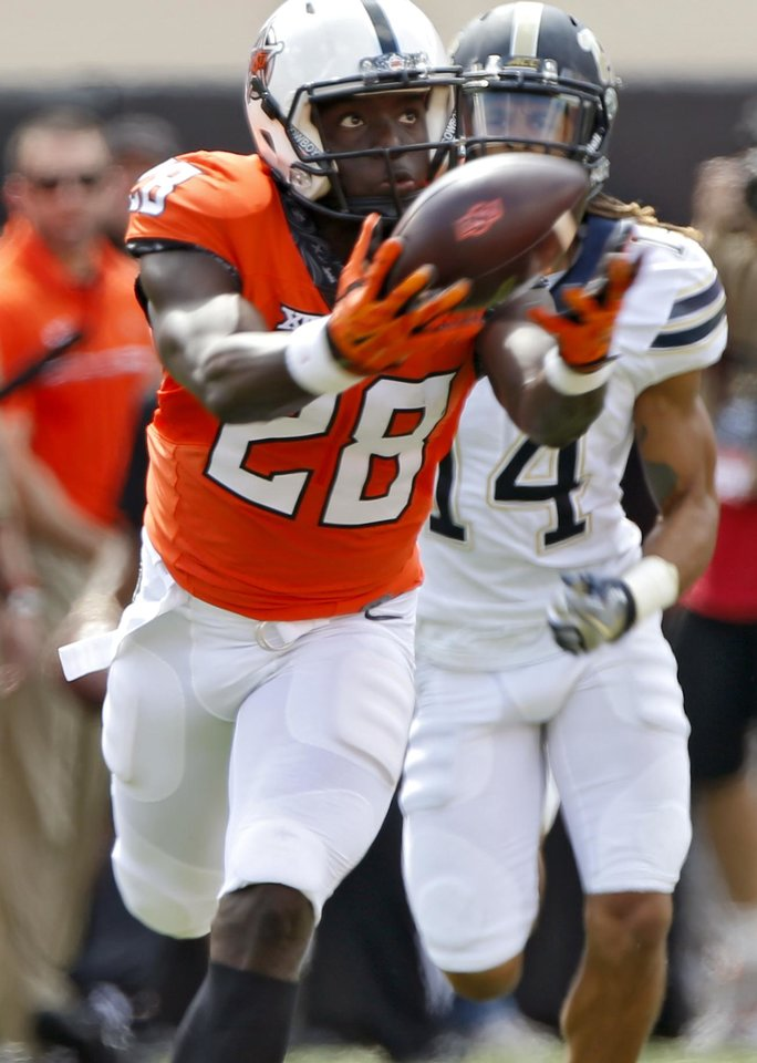 Photo - Oklahoma State's James Washington (28) makes a catch in front of Pittsburgh's Avonte Maddox (14) for a 92 yard touchdown on the first play from scrimmage during a college football game between the Oklahoma State Cowboys (OSU) and the Pitt Panthers at Boone Pickens Stadium in Stillwater, Okla., Saturday, Sept. 17, 2016. Photo by Chris Landsberger, The Oklahoman