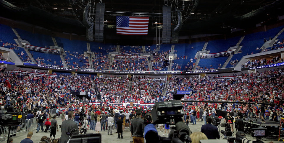 Photo - People listen to President Donald Trump speaks during a rally at the BOK Center in Tulsa, Okla., Saturday, June 20, 2020. [Sarah Phipps/The Oklahoman]