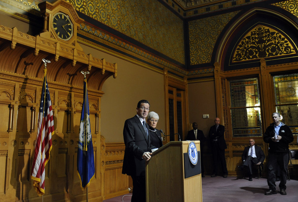 Photo - Connecticut Gov. Dannel P. Malloy speaks to the media at the Capitol in Hartford, Conn., Monday, Dec. 17, 2012.  A gunman walked into Sandy Hook Elementary School in Newtown, Conn., Friday and opened fire, killing 26 people, including 20 children. (AP Photo/Jessica Hill) ORG XMIT: CTJH107