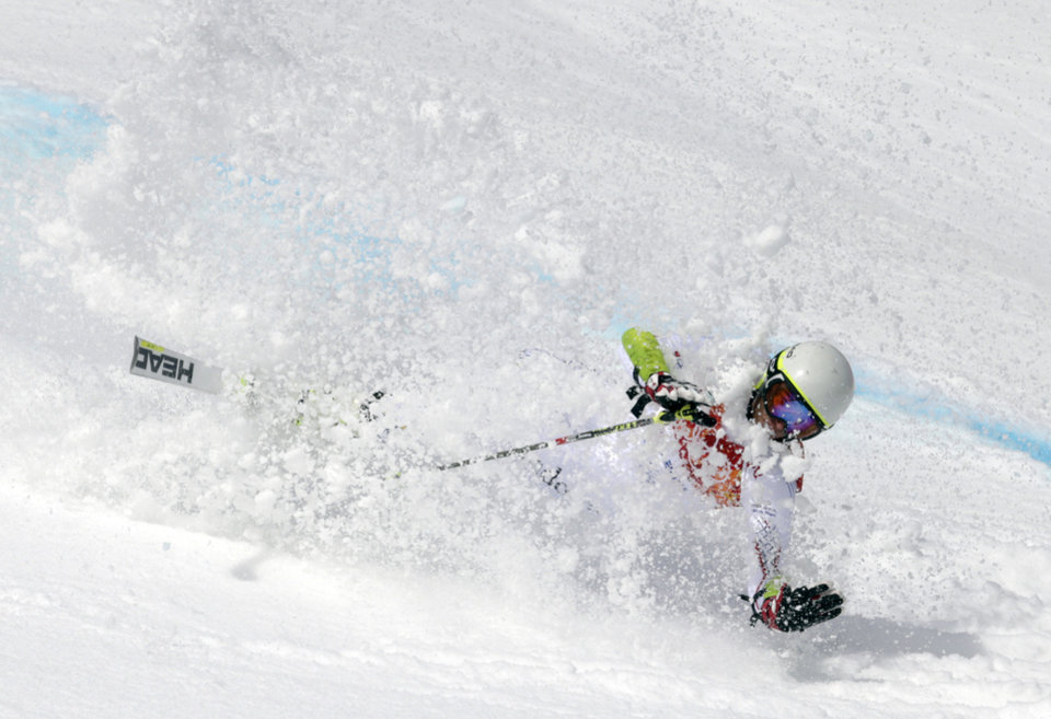 Photo - Andorra's Joan Verdu Sanchez crashes in the first run of the men's giant slalom at the Sochi 2014 Winter Olympics, Wednesday, Feb. 19, 2014, in Krasnaya Polyana, Russia. (AP Photo/Charles Krupa)