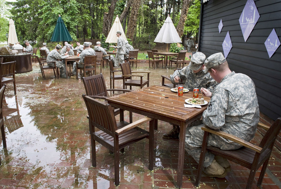 Photo - Soldiers in the 1st Battalion 163rd Field Artillery Unit of the Indiana Army National Guard take a short break from sandbagging Harmonie State Park in New Harmony, Ind. on Wednesday morning, April, 27, 2011 for,