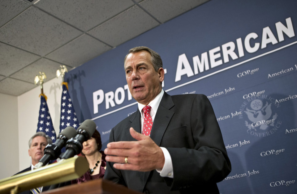 Photo - Speaker of the House John Boehner, R-Ohio, joined at left by Rep. Cathy McMorris Rodgers, R-Wash., and House Majority Whip Kevin McCarthy, R-Calif., far left, as they speak to reporters about the fiscal cliff negotiations after a closed-door strategy session at the Capitol in Washington, Tuesday, Dec. 18, 2012.  (AP Photo/J. Scott Applewhite)