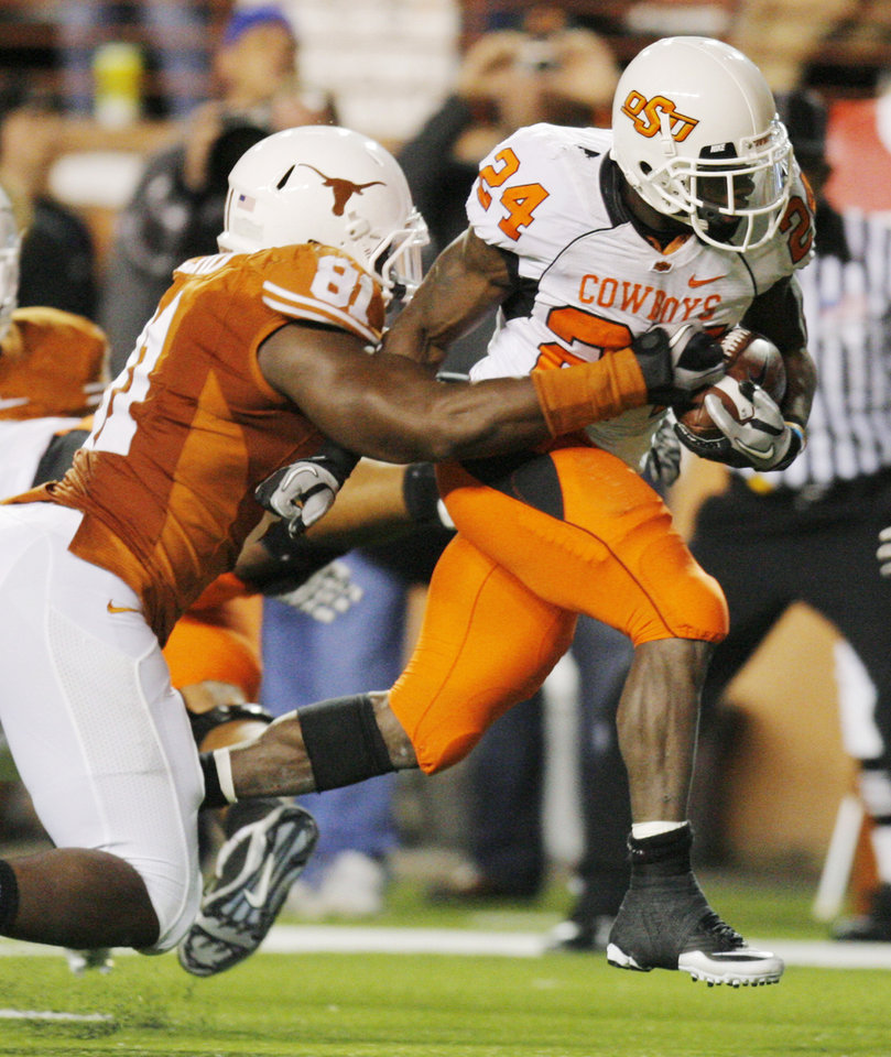 Photo - OSU's Kendall Huner (24) breaks away from Sam Acho (81) of Texas on a touchdown run in the second quarter during the college football game between the Oklahoma State University Cowboys (OSU) and the University of Texas Longhorns (UT) at Darrell K Royal-Texas Memorial Stadium in Austin, Texas, Saturday, November 13, 2010. Photo by Nate Billings, The Oklahoman