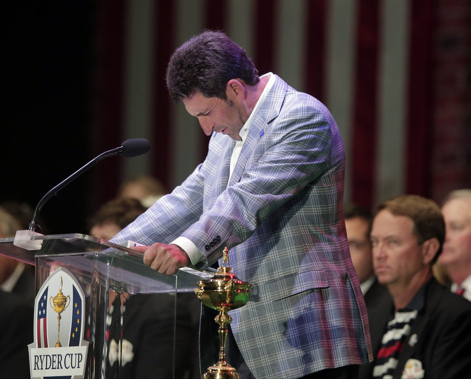 Photo - European team captain Jose Maria Olazabal breaks down as he speaks at the closing ceremony at the Ryder Cup PGA golf tournament Sunday, Sept. 30, 2012, at the Medinah Country Club in Medinah, Ill. (AP Photo/Charlie Riedel)  ORG XMIT: PGA253