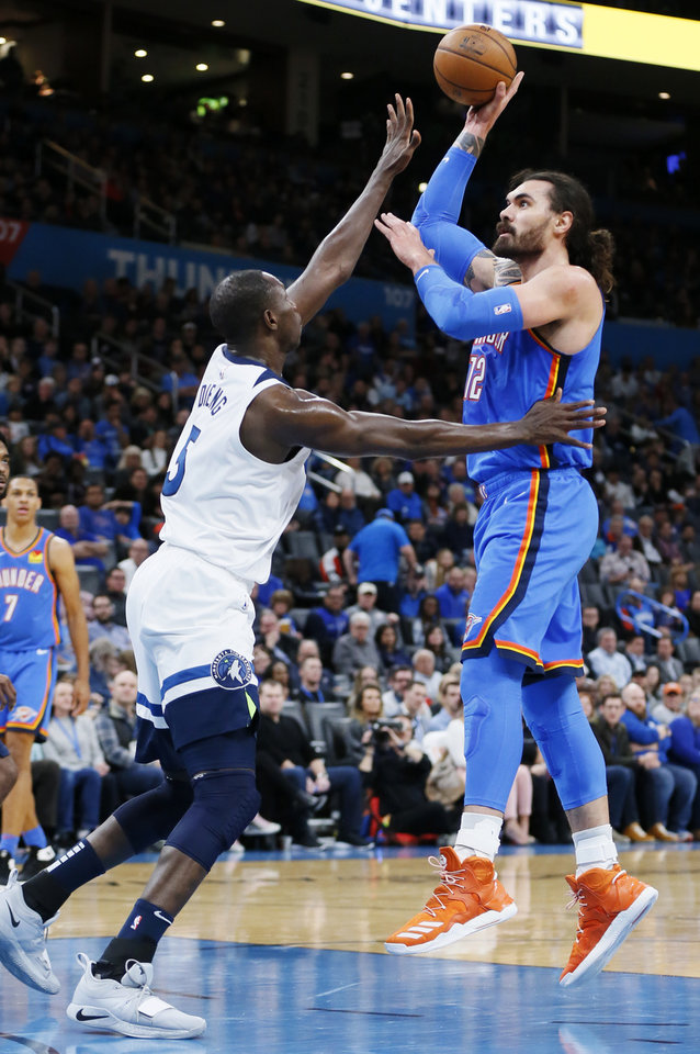 Photo - Oklahoma City's Steven Adams (12) shoots over Minnesota's Gorgui Dieng (5) in the second quarter during an NBA basketball game between the Minnesota Timberwolves and the Oklahoma City Thunder at Chesapeake Energy Arena in Oklahoma City, Friday, Dec. 6, 2019. [Nate Billings/The Oklahoman]