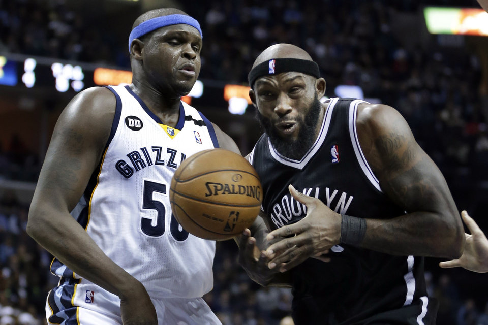 Brooklyn Nets' Reggie Evans, right, is pressured by Memphis Grizzlies' Zach Randolph (50) during the first half of an NBA basketball game in Memphis, Tenn., Friday, Jan. 25, 2013. (AP Photo/Danny Johnston)