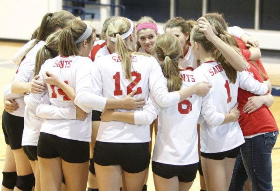 Photo - The OCS girls huddle before playing Cache in the Class 4A State Volleyball tournament at at Shawnee High School in Shawnee, OK, Friday, Oct. 7, 2011. By Paul Hellstern, The Oklahoman ORG XMIT: KOD