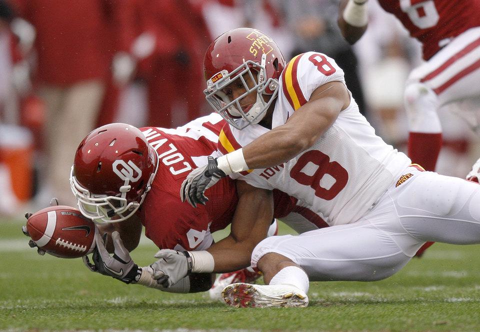 Oklahoma's Aaron Colvin (14) recovers a fumble in front of Iowa State's James White (8) during a college football game between the University of Oklahoma Sooners (OU) and the Iowa State University Cyclones (ISU) at Gaylord Family-Oklahoma Memorial Stadium in Norman, Okla., Saturday, Nov. 26, 2011. Photo by Bryan Terry, The Oklahoman
