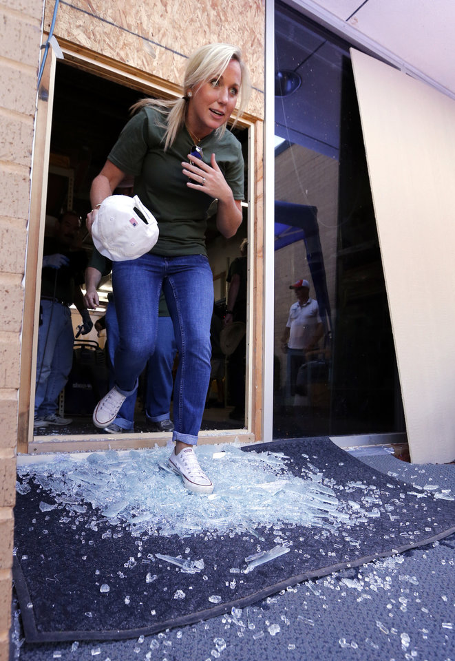 Photo -  Staff members use a broken window as an exit during an active shooter scenario on Safety Day at Moore Norman Technology Center. [PHOTO BY STEVE SISNEY, THE OKLAHOMAN]