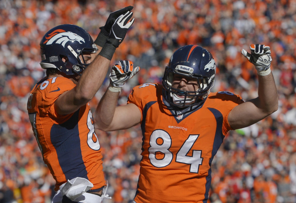 Photo - Denver Broncos tight end Jacob Tamme (84) celebrates his touchdown with teammate Denver Broncos wide receiver Eric Decker (87) during the first half of the AFC Championship NFL playoff football game in Denver, Sunday, Jan. 19, 2014. (AP Photo/Jack Dempsey)