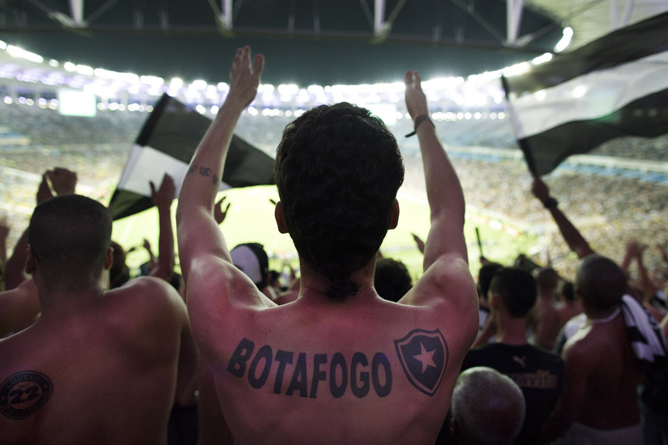 Photo - In this April 2, 2014 photo, fans of the Botafogo soccer team react during a Copa Libertadores game at Maracana stadium in Rio de Janeiro, Brazil. Soccer's big moment happens in June as the best players on the planet meet in Brazil for the World Cup. The international soccer tournament will be the first in the South American nation since 1950. (AP Photo/Leo Correa)