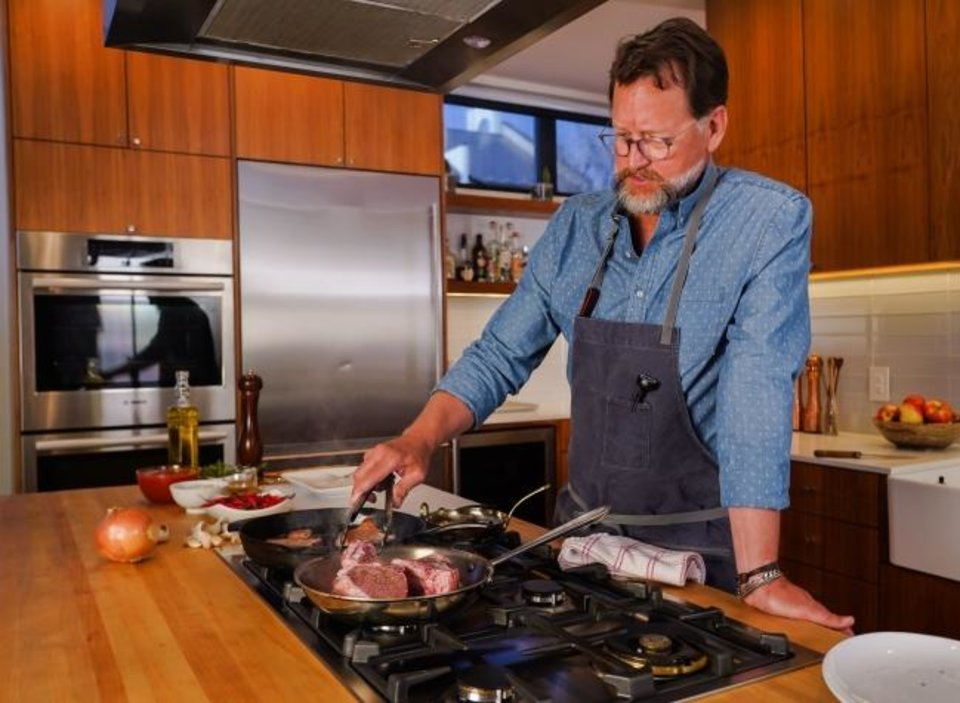 Photo -  Kurt Fleischfresser prepares one of his pork chop dishes for GoodvsGourmet.com. [PROVIDED BY OKLAHOMA NATURAL GAS]