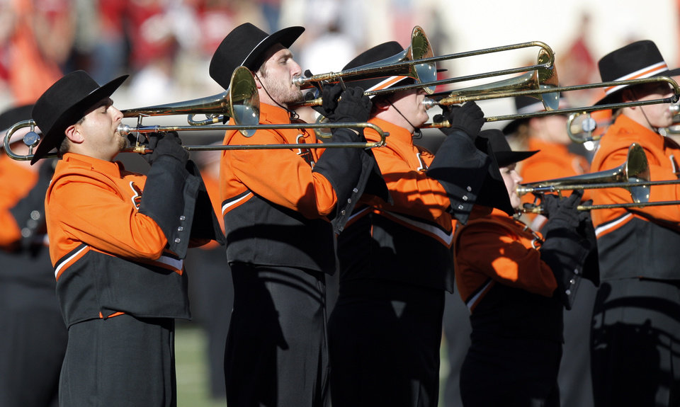 Photo - The OSU Cowboy Marching Band performs before the college football game between the Washington State Cougars (WSU) and the Oklahoma State Cowboys (OSU) at Boone Pickens Stadium in Stillwater, Okla., Saturday, September 4, 2010. Photo by Nate Billings, The Oklahoman