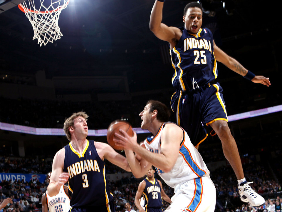 Photo - Indiana's Brandon Rush (right) and Troy Murphy (left) pressure a shot by Oklahoma City's Nenad Krstic during the NBA basketball game between the Indiana Pacers and the Oklahoma City Thunder at the Ford Center in Oklahoma City, Sunday, April 5, 2009. The Thunder lost 117 to 99. Photo by John Clanton, The Oklahoman