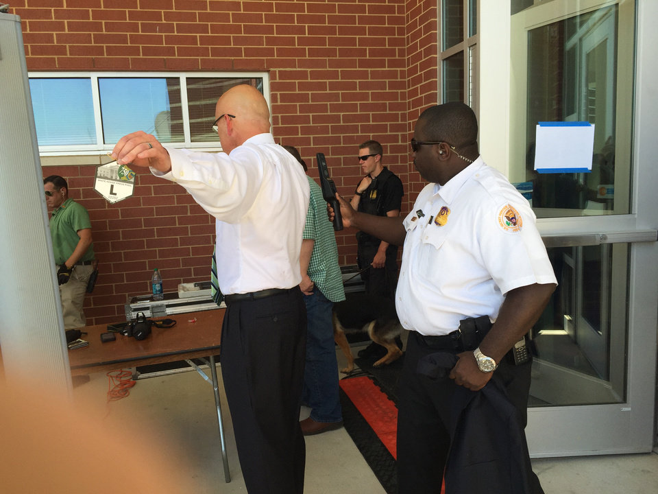 Photo - Security sweep at entrance to President Obama's address at Durant High School in Durant, Oklahoma on July 15, 2015. Jim Beckel, NewsOK