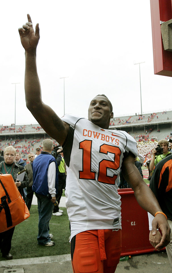 Photo - CELEBRATION: Adarius Bowman of OSU celebrates after the college football game between Oklahoma State University (OSU) and the University of Nebraska at Memorial Stadium in Lincoln, Neb., on Saturday, Oct. 13, 2007. By Bryan Terry, The Oklahoman    ORG XMIT: KOD