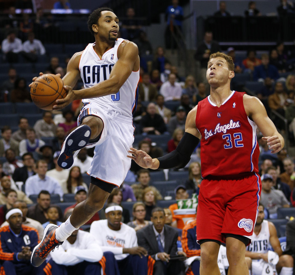 Photo - Charlotte Bobcats' Gerald Henderson (9) looks to pass as Los Angeles Clippers' Blake Griffin (32) defends during the first half of an NBA basketball game in Charlotte, N.C., Wednesday, Dec. 12, 2012. (AP Photo/Chuck Burton)