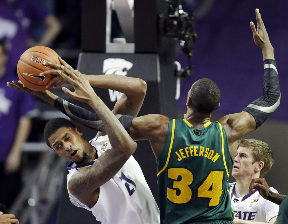 Kansas State forward Jordan Henriquez (21) tries to pull in a rebound against Baylor forward Cory Jefferson (34) during the second half of an NCAA college basketball game in Manhattan, Kan., Saturday, Feb. 16, 2013. Kansas State won 81-61. (AP Photo/Orlin Wagner)