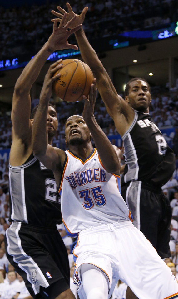 Photo - Oklahoma City's Kevin Durant (35) goes to the basket between San Antonio's Tim Duncan (21) and Kawhi Leonard (2) during Game 6 of the Western Conference Finals in the NBA playoffs between the Oklahoma City Thunder and the San Antonio Spurs at Chesapeake Energy Arena in Oklahoma City, Saturday, May 31, 2014. Photo by Bryan Terry, The Oklahoman