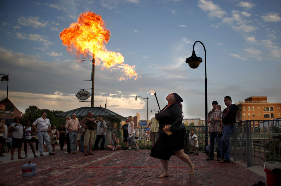 The Amazing Boobzilla breathes fire during the Carnival of Cleavage sideshow, Friday, June 11, 2010, in Bricktown in Oklahoma City. Photo by Sarah Phipps, The Oklahoman