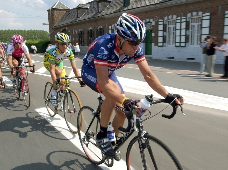FILE - In this July 6, 2004, file photo, U.S. Postal Service's Lance Armstrong rides ahead of Team Phonak's Tyler Hamilton,, center, and T-Mobile's Jan Ullrich, of Germany, during the third stage of the Tour de France cycling race between Waterloo, Belgium, and Wasquehal, northern France.  Admitting he cheated was a start. Now, it's all about whether Armstrong is ready to give details, lots of them, to clean up his sport. Hamilton, whose testimony helped lead to Armstrong's downfall, says if Armstrong is willing to provide information to clean up the sport, a reduction in the sanctions would be appropriate. (AP Photo/Peter Dejong, File)