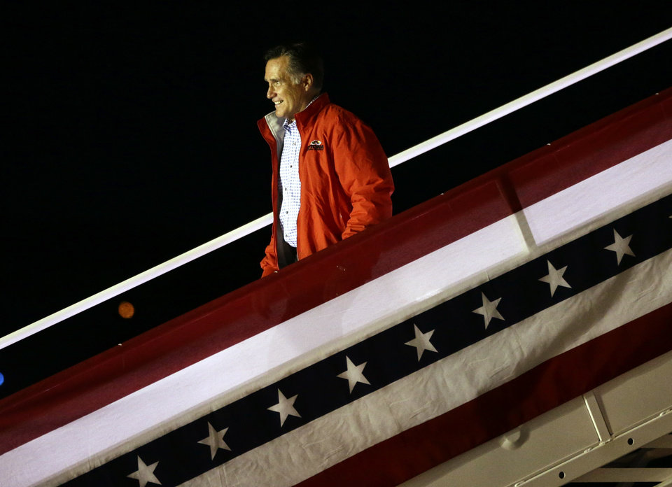 Photo -   Republican presidential candidate and former Massachusetts Gov. Mitt Romney steps off his campaign plane in Weyers Cave, Va., Sunday, Oct. 7, 2012. (AP Photo/Charles Dharapak)