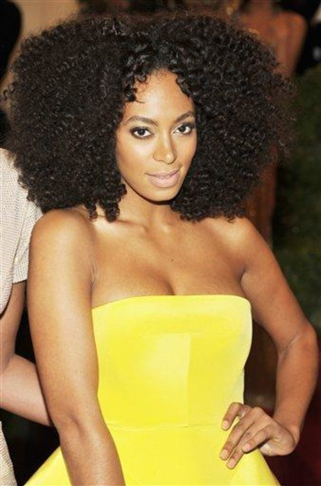 Photo - Solange Knowles arrives at the Metropolitan Museum of Art Costume Institute gala benefit, celebrating Elsa Schiaparelli and Miuccia Prada, Monday, May 7, 2012 in New York. (AP Photo/Charles Sykes)