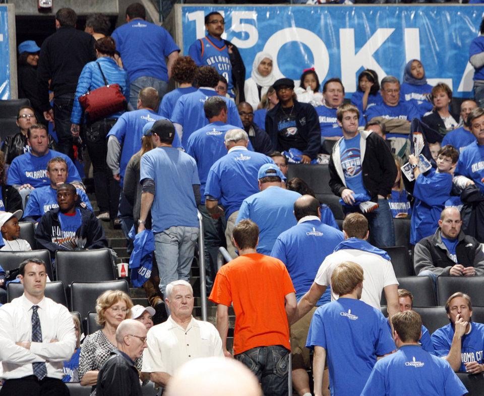 Photo - Fans begin to leave with more than a minute left in the second half during game one of the Western Conference semifinals between the Memphis Grizzlies and the Oklahoma City Thunder in the NBA basketball playoffs at Oklahoma City Arena in Oklahoma City, Sunday, May 1, 2011. Memphis won, 114-101. Photo by Nate Billings, The Oklahoman