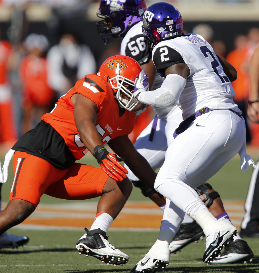 Oklahoma State's Ryan Simmons (52) sacks TCU's Trevone Boykin (2) during a college football game between the Oklahoma State University Cowboys (OSU) and the Texas Christian University Horned Frogs (TCU) at Boone Pickens Stadium in Stillwater, Okla., Saturday, Oct. 19, 2013. Photo by Chris Landsberger, The Oklahoman