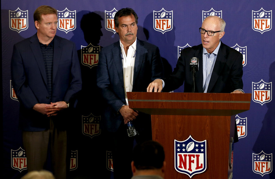 Photo - Rich McKay, right, President and CEO of the Atlanta Falcons and co-chairman of the NFL competition committee, speaks on the new rule changes voted on by NFL owners, as NFL Commissioner Roger Goodell, left, and St. Louis Rams head coach Jeff Fisher, the other co-chairman of the NFL competition committee, both listen in at the annual NFL football meetings at the Arizona Biltmore, Wednesday, March 20, 2013, in Phoenix. (AP Photo/Ross D. Franklin)