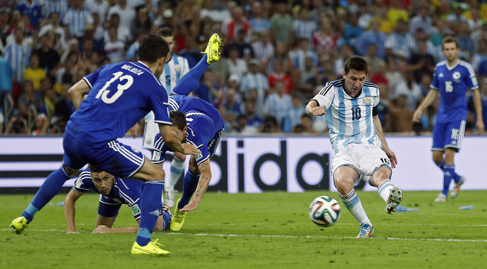 Photo - Argentina's Lionel Messi scores his side's second goal during the group F World Cup soccer match between Argentina and Bosnia at the Maracana Stadium in Rio de Janeiro, Brazil, Sunday, June 15, 2014.     (AP Photo/Victor R. Caivano)