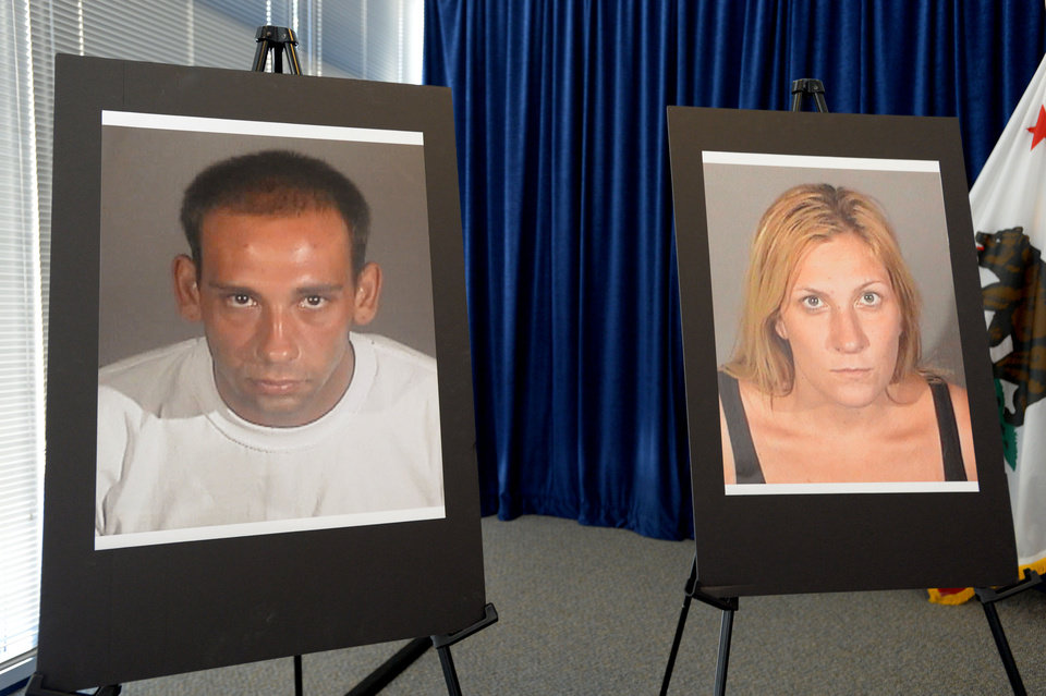Photo - During a news conference Thursday, July 24, 2014, in Long Beach, Calif., police display photos of Gus Adams and Andrea Miller. Police said they're deciding whether to arrest an 80-year-old man who shot a fleeing, unarmed burglar--Miller--despite her telling him she was pregnant, but they have arrested the woman's accomplice--Adams--on suspicion of murder for taking part in a crime that led to her death. (AP Photo/Long Beach Press-Telegram, Sean Hiller)